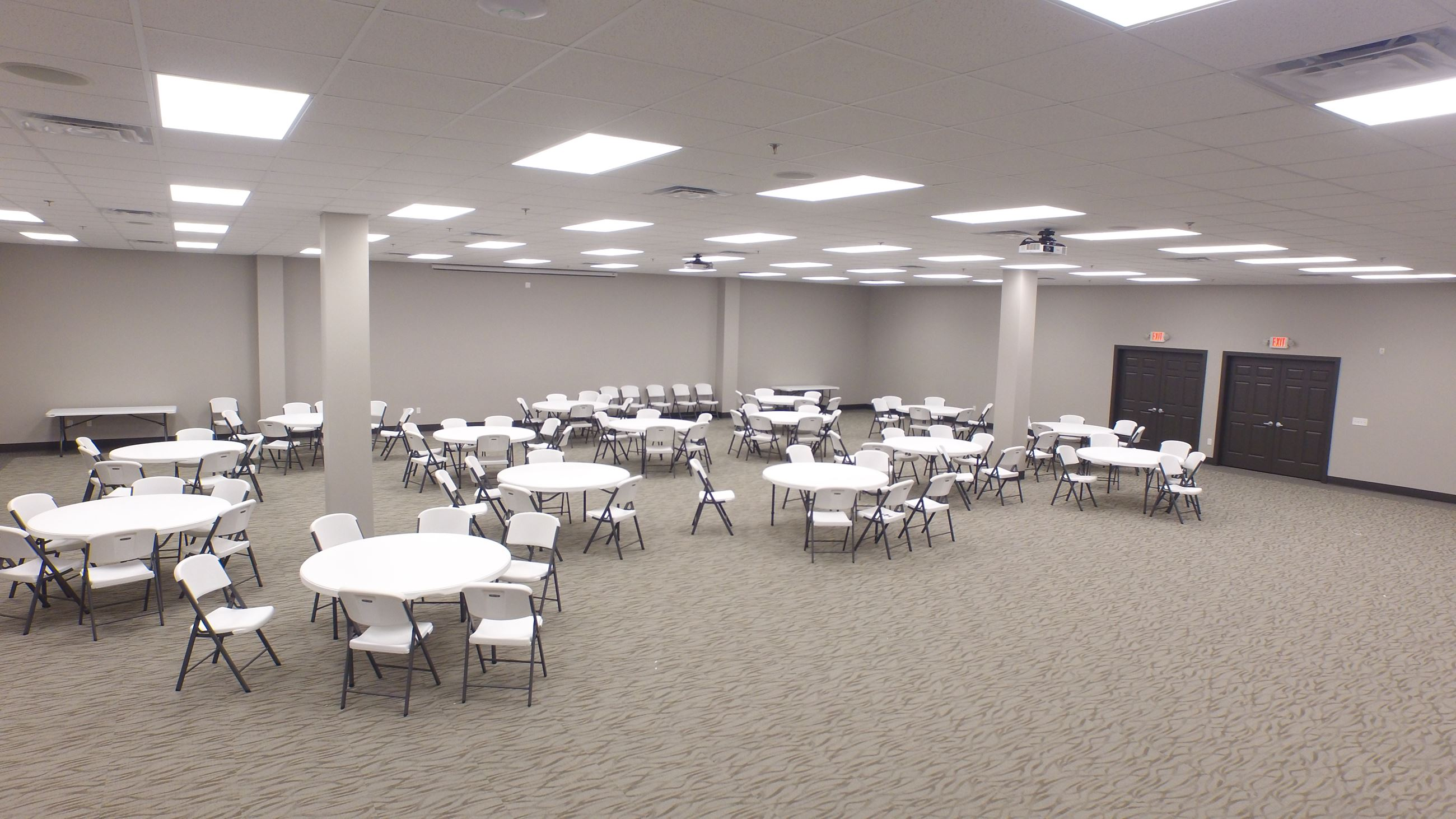 A view of the Gathering Hall with tables and chairs set up.